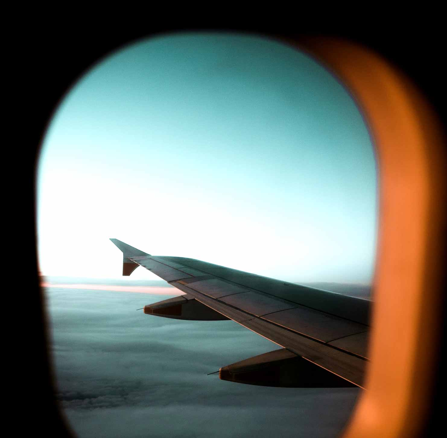 Looking at the wing of an aeroplane through the window