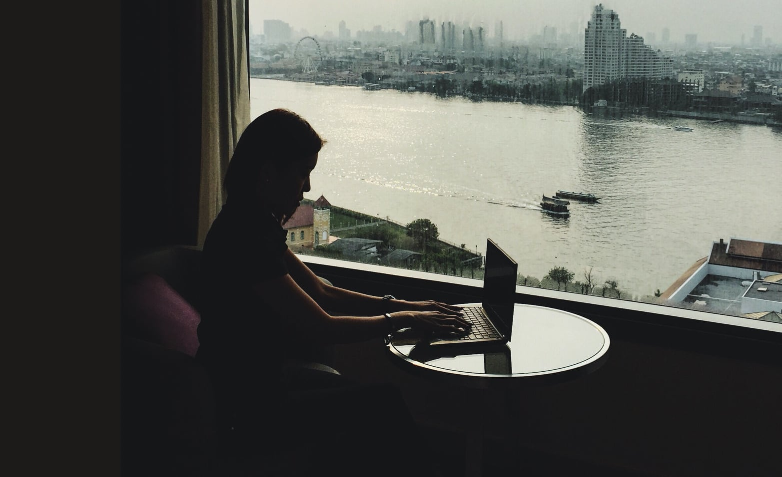 Working in a hotel room overlooking the river