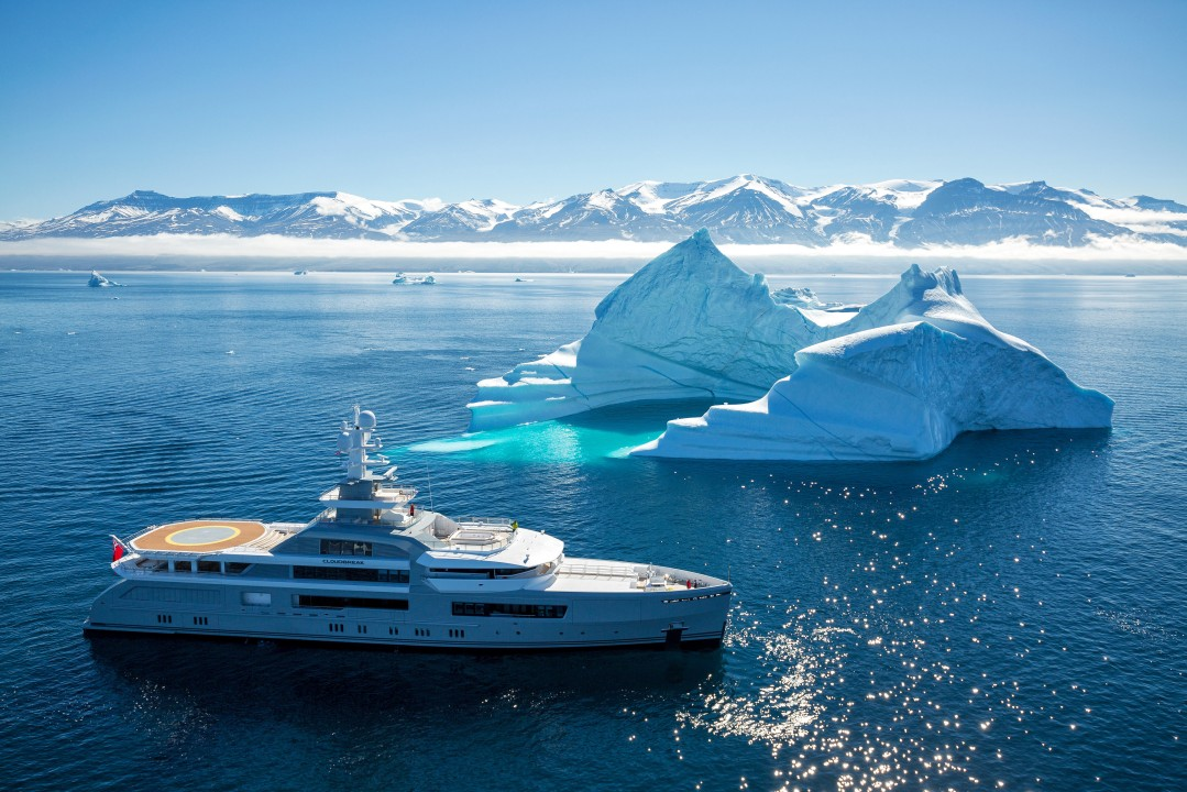 Yacht sailing near to icebergs